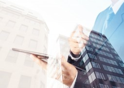 Double exposure of success businessman with abstract building